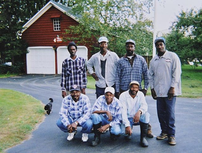Since the mid-1970s, a community of Jamaican men have joined the workforce each year through the U.S. Department of Labor's H-2A visa program, living and working at the orchard for months at a time. With some participants returning over decades and staying for many months out of the year and some making it a multi-generational practice, with fathers and sons joining the team, this group of men have become part of the Forrence family, and their skills, experience, and dedication are essential to the vitality of the family business. Forrence Orchards, Peru, NY, date and photographer unknown.