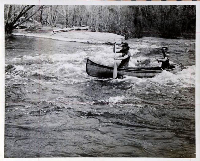 Frank and son Gary White paddling a 60-year-old canoe in the Rushton Canoe Race in May, 1971. Photo by Dwight Church, 1971.