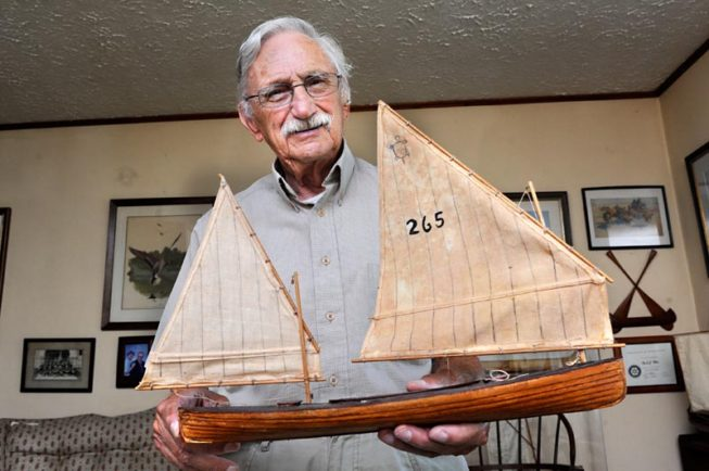 Frank White shows one of his model boats, 2012.