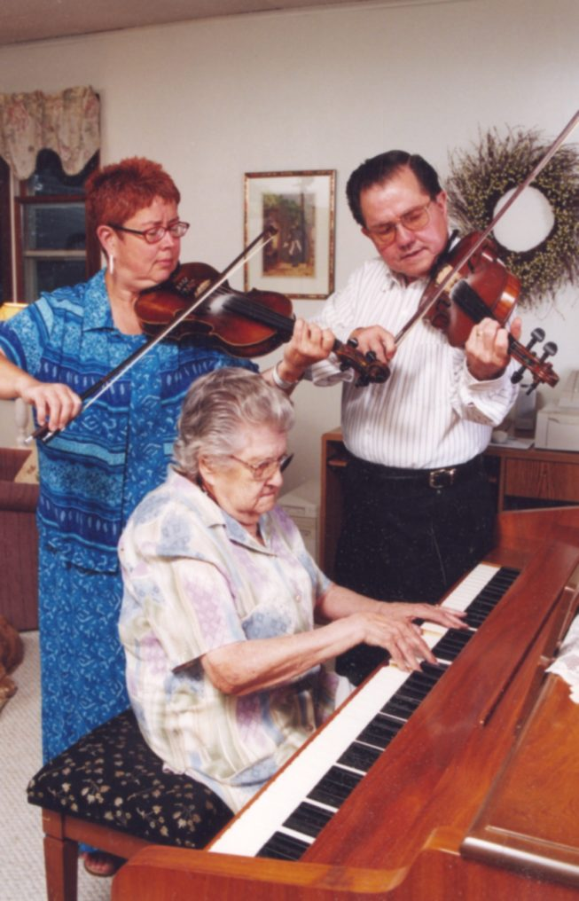Phyllis Ezero, mother Lois Lawrence Perkins, and brother Don Perkins (l. to r.) of the Perkins Family Band, Champlain Valley dance musicians, 2002.