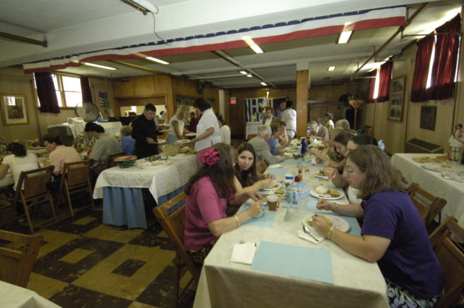 The community enjoys the meal and celebration on the day of the St. Vasilios Greek Orthodox Church Pastry Sale and Dinner.