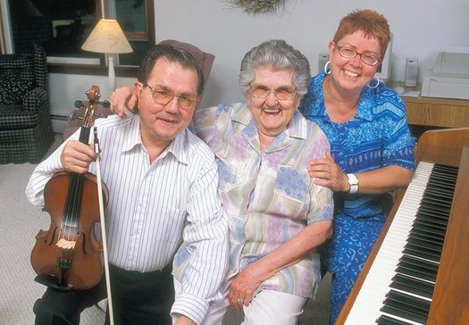 Don Perkins, mother Lois Lawrence Perkins, and sister Phyllis Ezero (l. to r.) of the Perkins Family Band, Champlain Valley dance musicians, 2002.