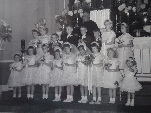 Loretta's First Communion (Loretta 4th from left, front row) at St. Hedwig's Catholic Church (Houseville, NY), c. 1958. Photographer unknown. Courtesy of Loretta Lepkowski.
