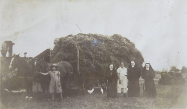 Loretta's maternal aunts Julia and Sister Regis, grandmother, and two other visiting nuns (left to right) at the Westernville farm, c. 1920s. Photographer unknown. Courtesy of Loretta Lepkowski.