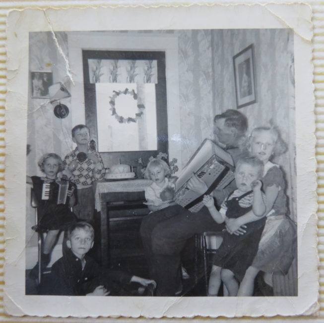 Loretta's father playing his accordion, which he learned to play by ear, in the original family house near Constableville. The instrument was later lost in a house fire, but a brother continues to play accordion by ear and loves polka music. Photo by Vicki Lepkowski, c. 1956. Courtesy of Loretta Lepkowski.