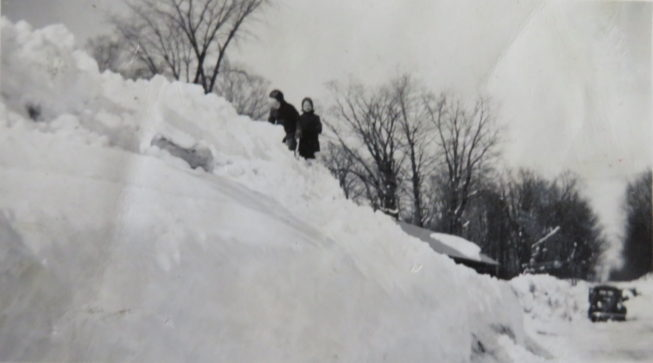 """Loretta's two oldest siblings climbing a big snowbank on their farm in the late 1940s, """"when the winters had lots and lots of snow."""" Photo by Vicki Lepkowski. Courtesy of Loretta Lepkowski."""