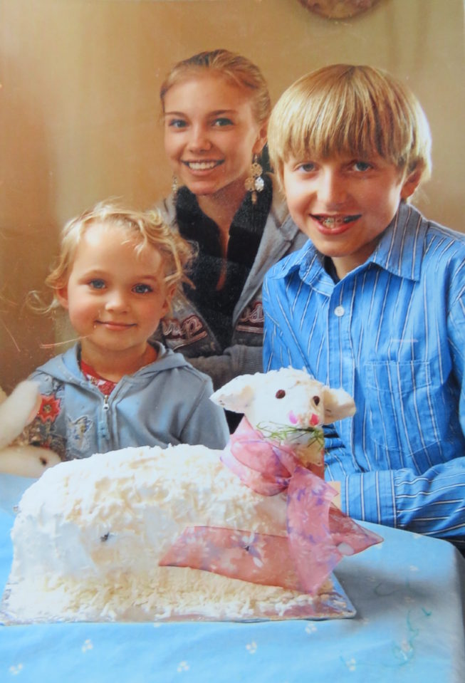 Loretta's niece, daughter, and son (left to right) with the Easter lamb cake. Loretta and her family continue to carry on many of the cultural traditions she grew up with. Photo by Loretta Lepkowski, c. 2008. Courtesy of Loretta Lepkowski.