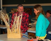 Basketmaker Mick Jarvis working with a student at his March packbasket class at TAUNY.